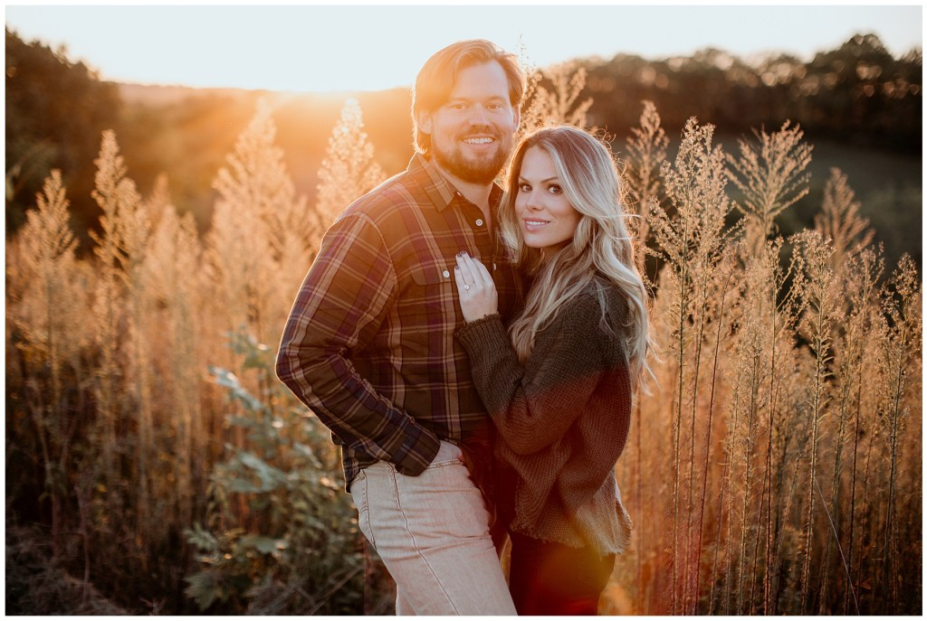 couple posing in golden light during preservation park engagements