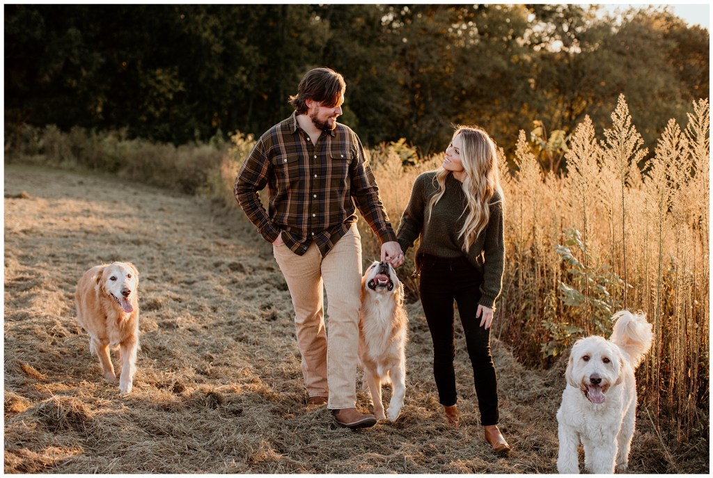couple walking with dogs during tennessee engagements