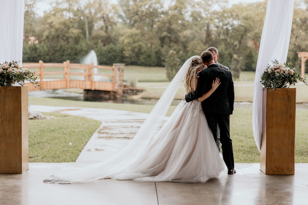 bride and groom hugging after ceremony using wedding day timeline