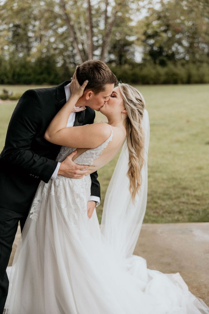 bride and groom kissing after wedding ceremony at sycamore farmsq