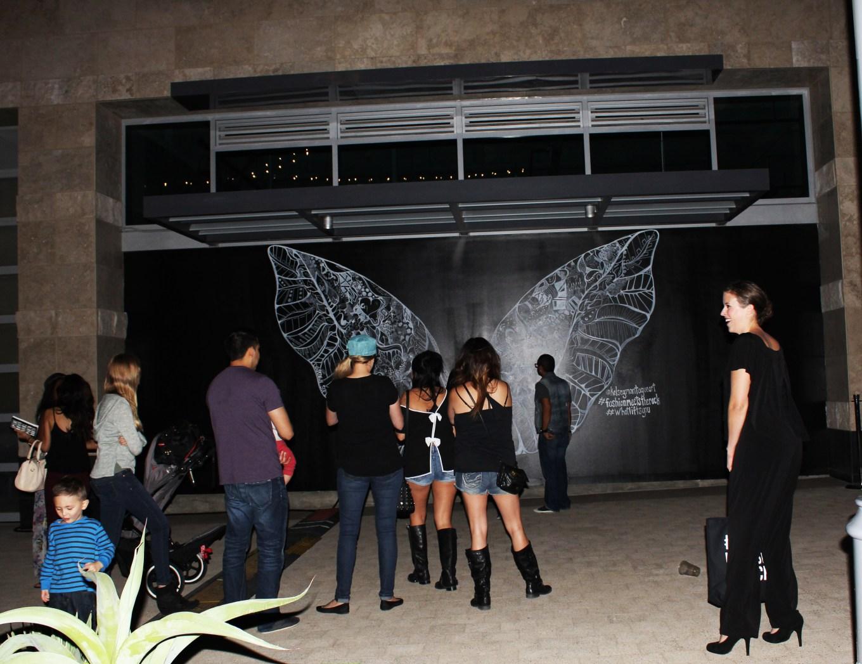 Kelsey Montague Art wings group of people