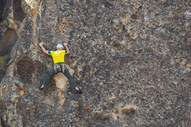 man doing outdoor rock climbing