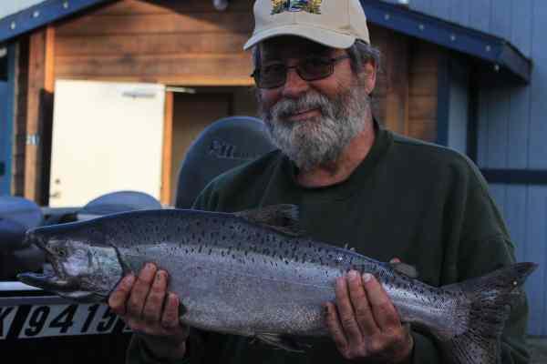Alaska King Salmon Fishing - Dave holding a small Alaska king salmon
