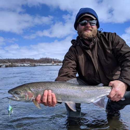 Alaska Trout Fishing - Kenai Riverside Resort guide holding a pretty Kenai River rainbow trout