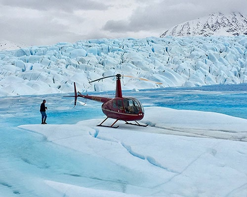 Helicopter sits atop the Harding Ice Field as part of our two day Glacier Hiking & Climbing Adventures