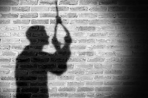 Shadow of man with a noose
