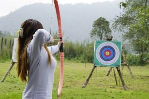 Woman shooting at target
