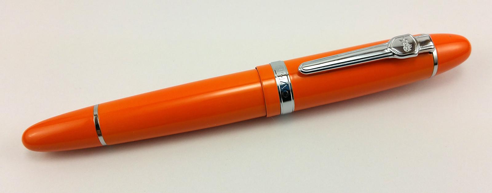 A huge, orange Jinhao 159 fountain pen.