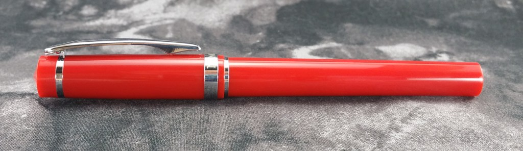 Nemosine Singularity Fountain Pen, capped and illustrating the tapering from the middle of the pen toward the ends