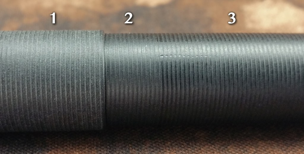 A close-up shot of the pen's finish showing various blemishes and inconsistencies in machining. Area 1 has the dullest finish, found on the cap. Area 2 is less dull than the cap and can be found on the barrel near the mouth. Area 3 shows the finish on the majority of the barrel, which is the shiniest part. You can also see some machine marks in area 3 where the lathe didn't cut all the way around the barrel and bit into the surface a bit.