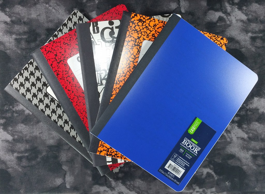 The covers of Five Cheap Composition Notebooks, four from Norcom (Brazil, Colombia, USA, Vietnam) and one Casemate (China)