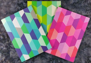 The three Greenroom Recycled Notebooks showing the three cover designs