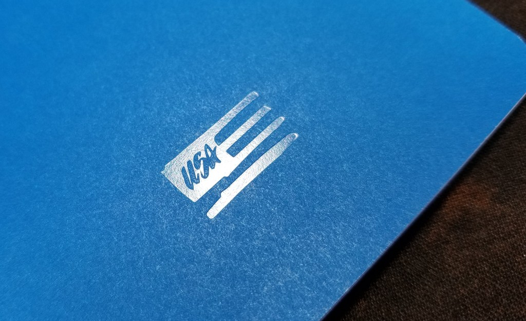 Close shot of the embossed USA logo on the back cover of the Nock Co. Nikko Blue pocket notebooks