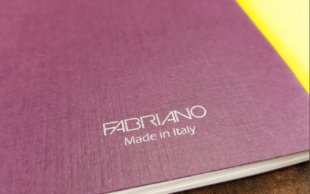 Close-up shot of the Fabriano logo on the back of the wine notebook. This is the only printing on the cover at all.