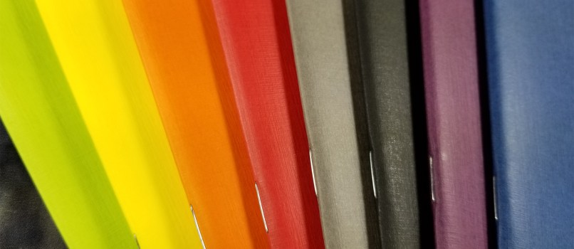 A rainbow of colors, this image shows the warm and cool colors available for the Fabriano EcoQua pocket notebooks.