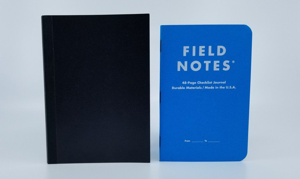 A size comparison between the A6 Kokuyo Systemic Notebook Refill and a standard pocket-sized Field Notes notebook