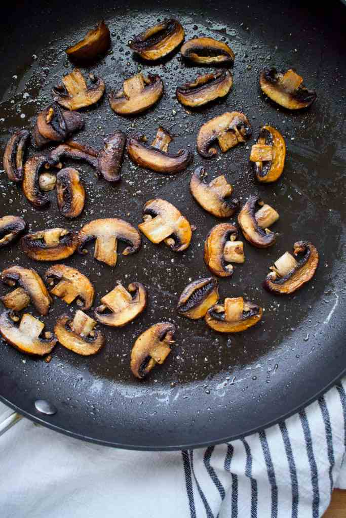 Sauteed Crimini Mushrooms, browned and crisped and ready to top the burgers