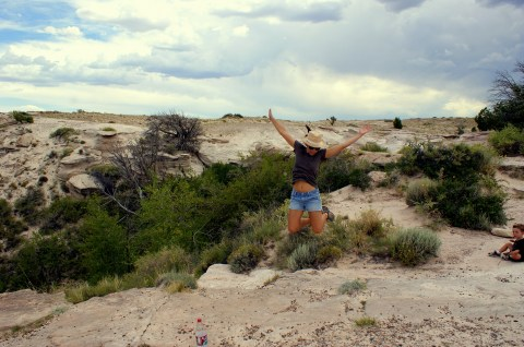 Jumping at Agate Bridge in the Petrified National Monument. Photo/Kendra Yost