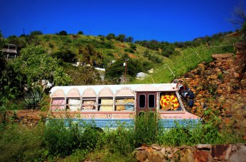 A decorated bus sits on a hill in Bisbee Arizona. Photo/Kendra Yost