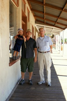 Three generations with Great Grandpa Rhinehart in Tombstone Arizona. Photo/Kendra Yost