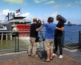 A camera crew shooting a ferry on the Mississippi River. Photo/Kendra Yost