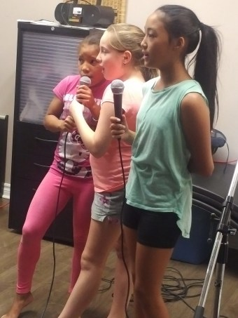 Children sing Karaoke at Summer Camp