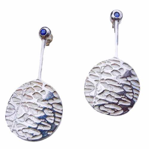 A pair of sterling silver, Sume studs with two flush set, blue sapphires