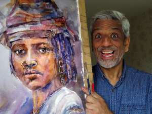 Artist Ken Maharajah with watercolour painting of African woman