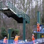 Metal flight of steps moved into position by crane