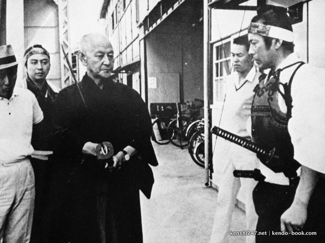 Takano Hiromasa (left) advising Mifune Toshiro on swordplay on set