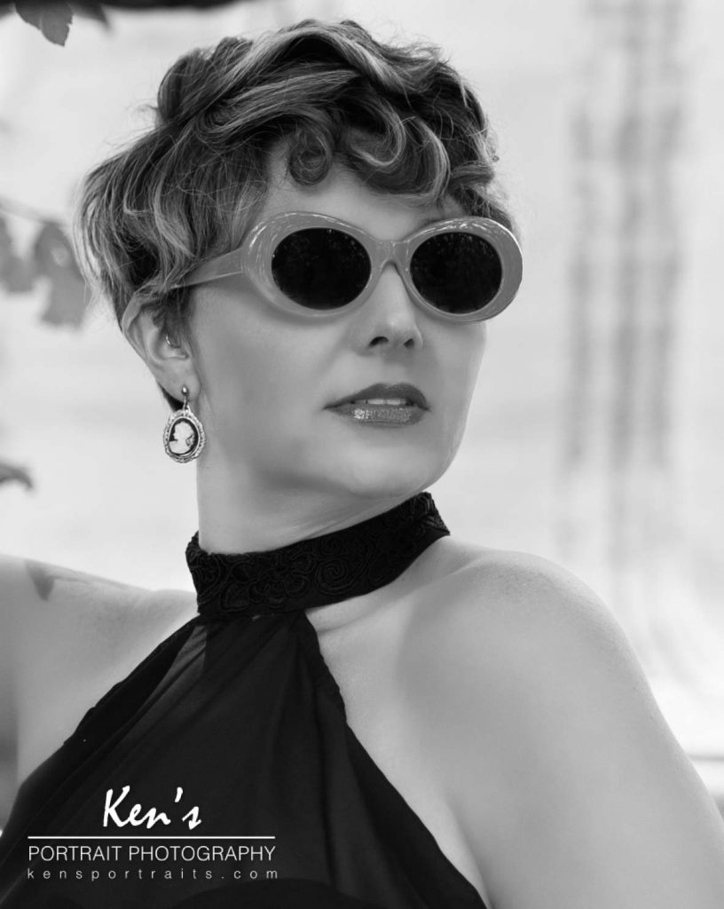 This image shows off the versatility of Lori's look. Jill's makeup and hair styling, combined with the wardrobe selection, and the retro looking sunglasses, gives Lori a 1950 ish movie star look.