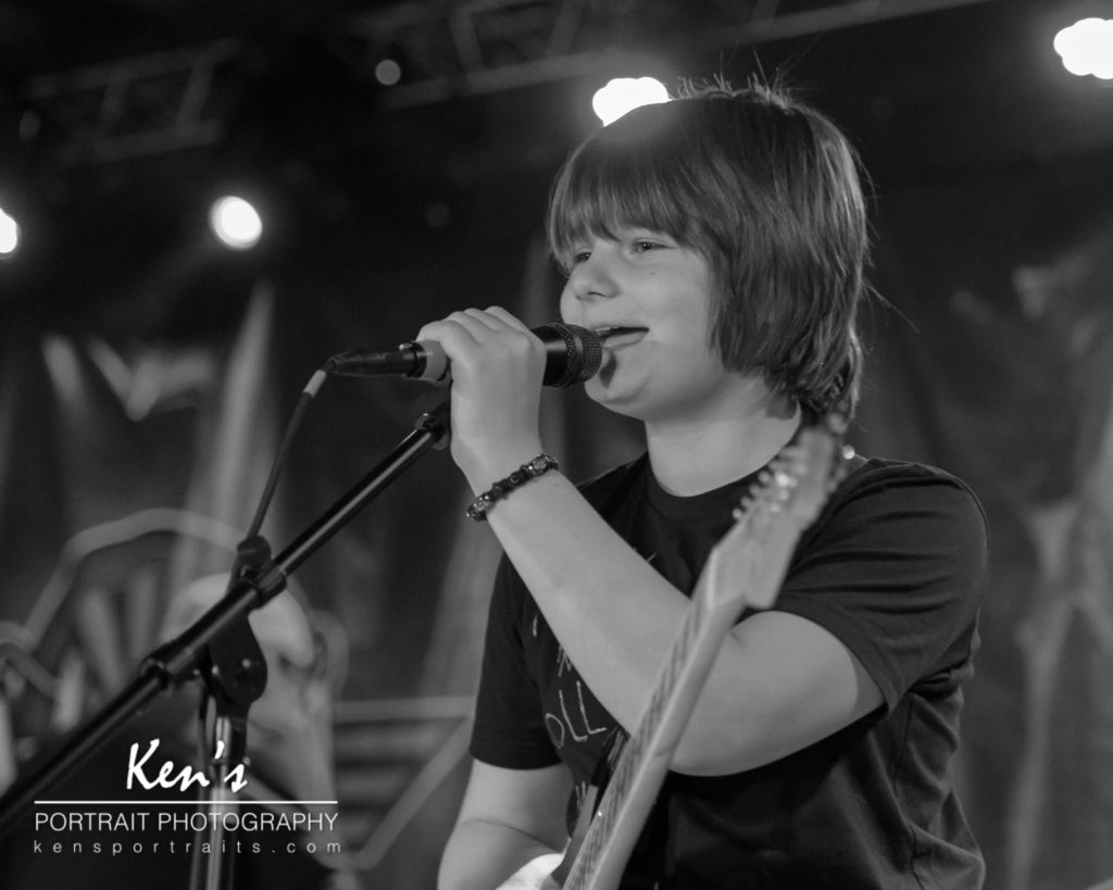 Rock School Band Show by Kens Portrait Photography. We recently photographed a group of wonderfully talented young musicians at the Modern Day Music Rock School Band Show at Wicked Eatery Pub and Entertainment in Clifton Park, NY. There were six bands who played for about two hours, performing a variety of modern, contemporary, and classic rock and roll songs. Some of the talented young men and women displayed their exceptional musical abilities by playing multiple instruments along with vocal performances. These talented musicians covered bands and artists such as Queen, Cold Play, Billy Joel, and more. They were so much fun to listen to.