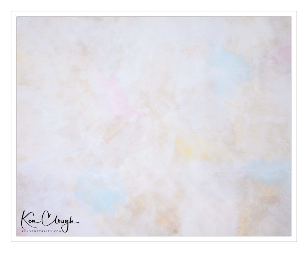 Spring Breeze Hand-Painted Backdrop by Kens Portrait Photography. We want your images to look special and unique, like you. We do not want your images to look like they were taken in every other photography studio. That is why we take great pride in our hand-painted backdrops. Our creative team was back in the studio this past weekend working on a new backdrop. Spent the day in the Studio with interns Stephen and Tara hand painting a new canvas backdrop. Stephen and Tara did a great job. We named this backdrop Spring Breeze.  The Spring Breeze hand-painted backdrop is light and playful with just hints of color and wonderful warm undertones tones. It is waiting for you to stop by the Studio for a portrait. Our studio provides a beautiful, large, and open creative space. There are so many photographic and creative possibilities to capture images for your professional portrait, a family portrait, an engagement portrait, a fashion portrait, a senior portrait, and more!