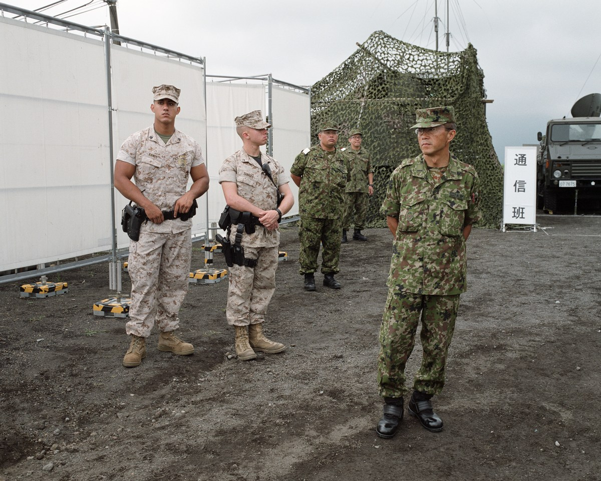 The Japanese Self Defense Force conducting an exercise for the Japanese public on a training field in Shizuoka with the U.S. military. Shizuoka, August 2015.