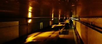 man and bike in tunnel