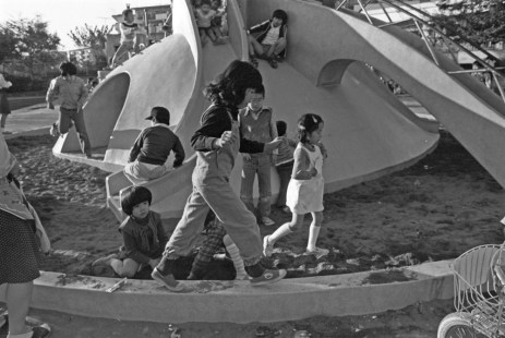 Children at a playground on the grounds of a danchi, in 1975 Japan.