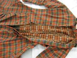 Dress open to reveal contrasting plaid lining