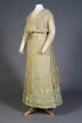 The custom mount creates the silhouette of the period for this green silk and lace dress, ca. 1915-17, (KSUM 1996.58.391).