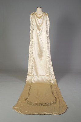 Back view of silk satin wedding dress showing the train embroidered in silk, KSUM 1983.1.334.