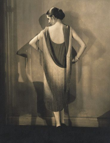In this photograph the dress is unfastened but clearly shows how it drapes. Marion Morehouse in Chanel dress photographed by Edward Steichen