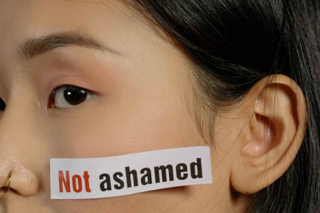 woman with not ashamed sticker