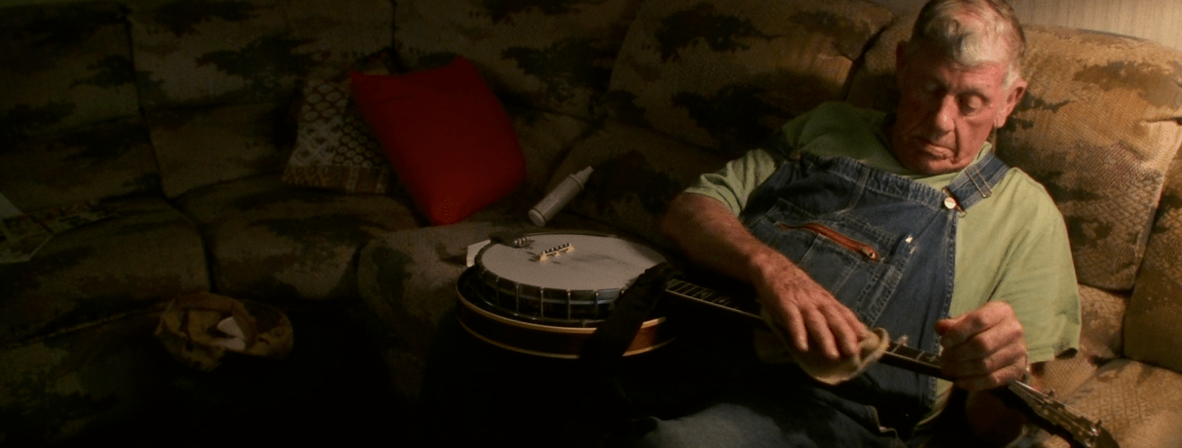 Lee Sexton cleaning his banjo in the film, Linefork. Photo courtesy of Linefork filmmakers.