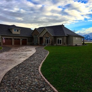 Custom stamped colored concrete driveway