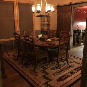 Barn door leading to private wine room
