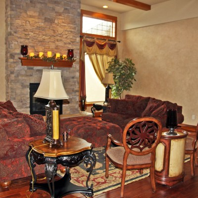 Formal living room with stone fireplace