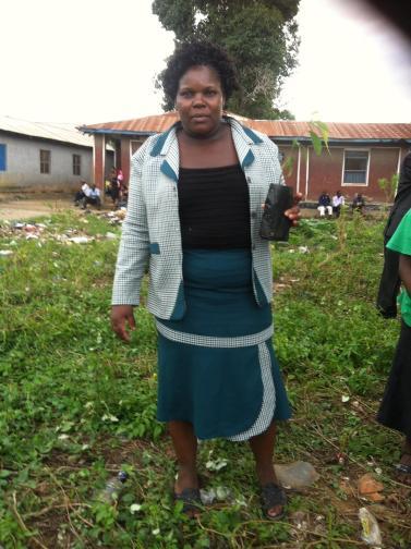 church lady holding tree seedling