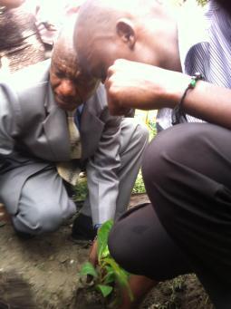 Pastor Shake planting a tree