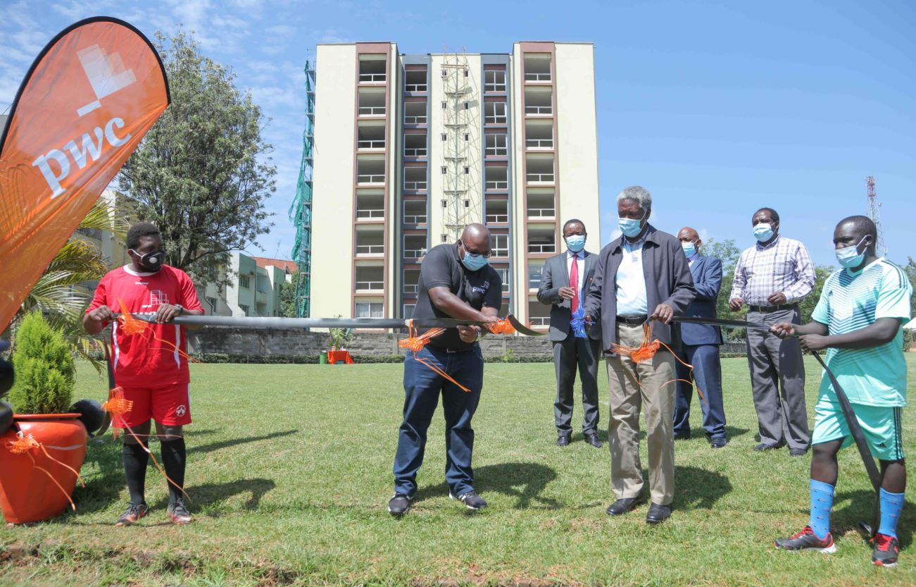 PwC Associate Director Finance, Joseph Nzou, (L), officially opening the football pitch at Parklands Baptist Church beside Senior Pastor Parklands Baptist Church, Ambrose Nyangao. This was during PwC commissioning of football pitch at the church.