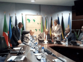Senior officials from AFDB and Shelter Afrique during the signing of the deal in Khushee Towers in Nairobi