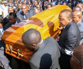 President Uhuru aiding in carrying a coffin